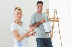 Couple with color swatches and ladder in a new house Stock Photo