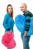 Couple with color teddy hearts Stock Photos