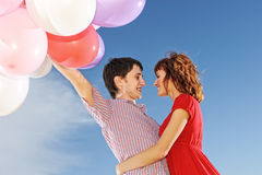 Couple with colorful balloons Stock Image