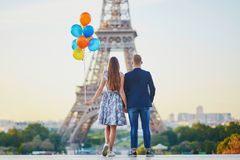 Couple with colorful balloons near the Eiffel tower Stock Photo
