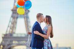 Couple with colorful balloons near the Eiffel tower Stock Photos