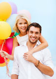 Couple with colorful balloons at seaside Stock Photography