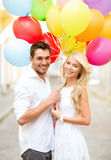 Couple with colorful balloons Royalty Free Stock Photo