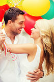 Couple with colorful balloons Royalty Free Stock Images