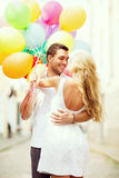 Couple with colorful balloons Stock Photo