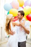 Couple with colorful balloons Royalty Free Stock Photos
