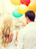 Couple with colorful balloons Stock Photos