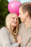 Couple with colorful balloons Royalty Free Stock Image