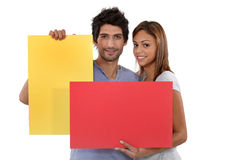Couple with colorful cards Stock Photography