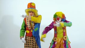 A couple of colorful clowns are dancing a funny dance showing holiday emotions stock footage
