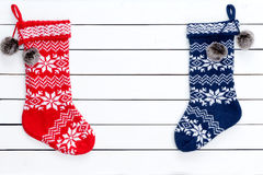 Couple colorful patterned Christmas stockings. As borders on white wooden background copy space in middle royalty free stock images
