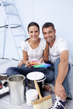Couple with colour samples to paint Stock Images