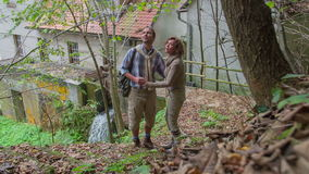 Couple comes to the local water mill stock video footage