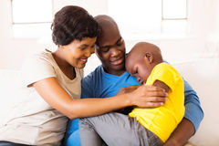 Couple comforting ill son Stock Photography