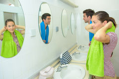 Couple in communal shower area. Couple in the communal shower area Stock Images