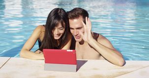 Couple communicates with friends on digital device stock video footage