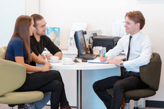 Couple communicating with a salesman Stock Photography