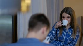 Couple communication leisure girl drink tea talk. Couple communication leisure. girl drinking tea and relaxing at home talking to a guy. young man and woman stock footage