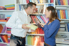 Couple comparing linen in store Royalty Free Stock Image