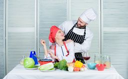 Couple compete in culinary arts. Reasons why couples cooking together. Cooking with your spouse can strengthen. Relationships. Woman and bearded men culinary royalty free stock photo