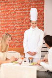Couple complimenting the chef Royalty Free Stock Images