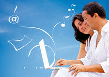 Couple with a computer Royalty Free Stock Image