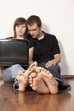 Couple with computer Stock Photos
