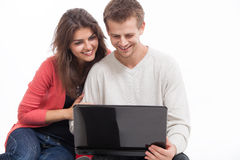 Couple at the computer. Man and women sitting at a computer Royalty Free Stock Images