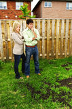 Couple concerned about lawn Royalty Free Stock Photo