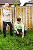 Couple concerned about lawn Stock Image