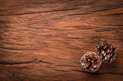 Couple of cones on wooden table Stock Photography