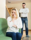 Couple conflict. Portrait of unhappy women after quarrel at living room at the home royalty free stock photos