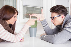 Couple in confrontation pointing at each other with challenge at Stock Photo