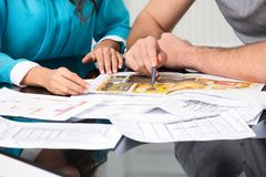 Couple is considering future apartment design Stock Photography