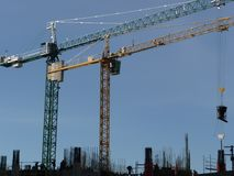 Couple of construction cranes. At Buenos Aires Stock Photo