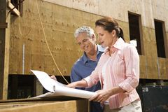 Couple on construction site. stock images