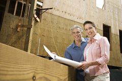 Couple on construction site. Royalty Free Stock Photo
