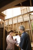 Couple on construction site. Royalty Free Stock Image