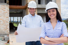 Couple at a construction site Stock Photography