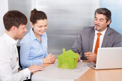 Couple And Consultant Discussing Together Royalty Free Stock Images