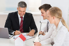 Couple Consulting Estate Agent Royalty Free Stock Photo