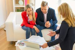 Couple consulting professional adviser. Middle aged couple consulting professional adviser stock image