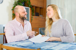Couple with contract for buying apartment Stock Images