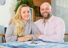 Couple with contract for buying apartment Royalty Free Stock Photography