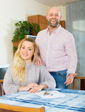 Couple with contract for buying apartment Stock Photography