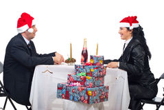 Couple conversation at Christmas dinner table Stock Photo