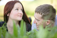 Couple in conversation at a  meadow Royalty Free Stock Images