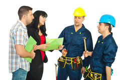 Couple conversation with workers team. Couple having conversation with workers team for renovating their house and holding folders isolated on white background Stock Photography