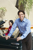Couple With A Convertible Stock Images
