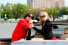 Couple in convertible car Royalty Free Stock Images